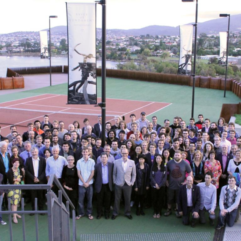 Group shot of CoEPP from our annual workshop in Hobart and shows us out the front of Mona (Museum of Old and New Art).