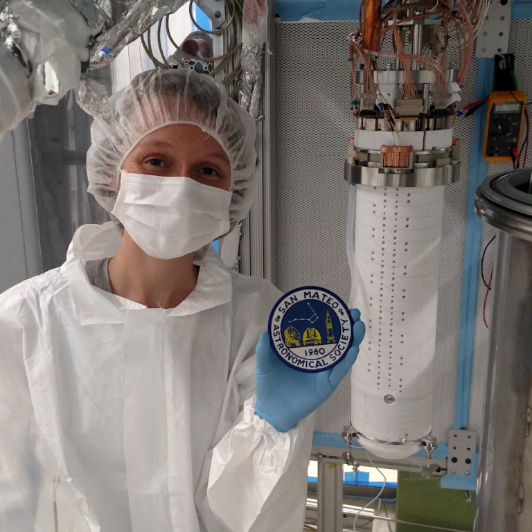 Kelly standing in the System Test clean room next to the exposed detector.