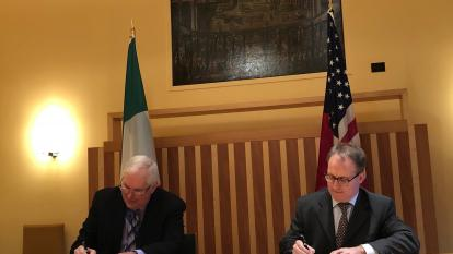 Jim Siegrist, associate director of the DOE Office of High-Energy Physics, and Maurizio Greganti, deputy chief of mission for the U.S. Embassy to Italy, sign an agreement to collaborate on Fermilab's PIP-II project.