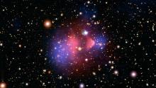 "This composite image shows the galaxy cluster 1E 0657-56, also known as the ""bullet cluster."" This cluster was formed after the collision of two large clusters of galaxies, the most energetic event known in the universe since the Big Bang."