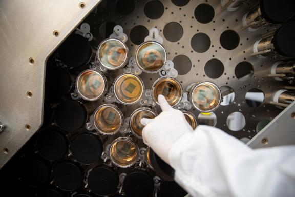 A researcher at Brown University installs photomultiplier tubes for a component of the LUX-ZEPLIN dark matter search experiment. (Credit: Nick Dentamaro/Brown University)