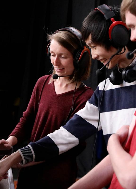Kelly Stifter, Jerry Kuang, and Mitchell McIntire prepare for their participation in the Hearthstone Collegiate Championships.