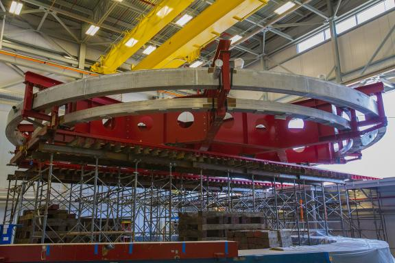 The 50-foot-wide Muon g-2 electromagnet at rest inside the Fermilab building that will house the experiment.